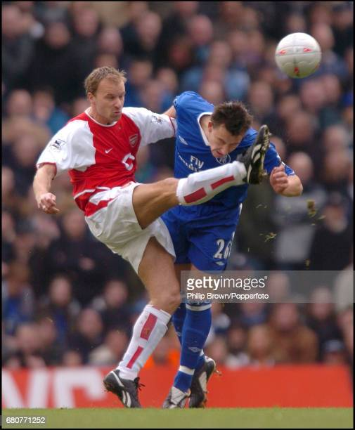 Dennis Bergkamp of Arsenal and John Terry of Chelsea in action during the FA Cup fifth round match between Arsenal and Chelsea at Highbury in London...