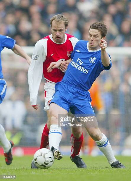 Dennis Bergkamp of Arsenal battles for the ball with Scott Parker of Chelsea during the FA Barclaycard Premiership match between Chelsea and Arsenal...