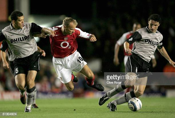 Dennis Bergkamp of Arsenal battles with Mark Van Bommel and Wilfred Bouma of PSV Eindhoven during the UEFA Champions League, Group E match between...