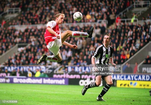 Dennis Bergkamp of Arsenal controls the ball as Andrew O'Brien of Newcastle looks on during the Premier League match between Newcastle United and...