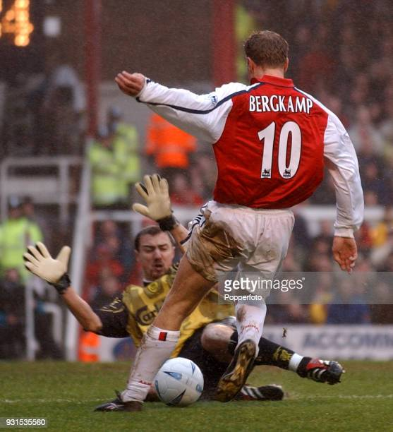 Dennis Bergkamp of Arsenal is denied by Jerzy Dudek of Liverpool during the AXA Sponsored FA Cup fourth round match at Highbury in London on January...