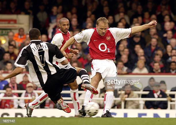 Dennis Bergkamp of Arsenal is tackled by Jermaine Jenas of Newcastle United during the FA Barclaycard Premiership match between Arsenal and Newcastle...
