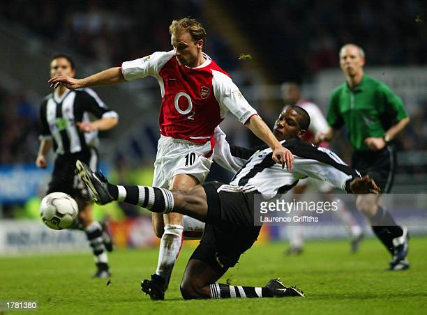 Dennis Bergkamp of Arsenal is tackled by Titus Bramble of Newcastle United during the FA Barclaycard Premiership match held on February 9 2003 at St...