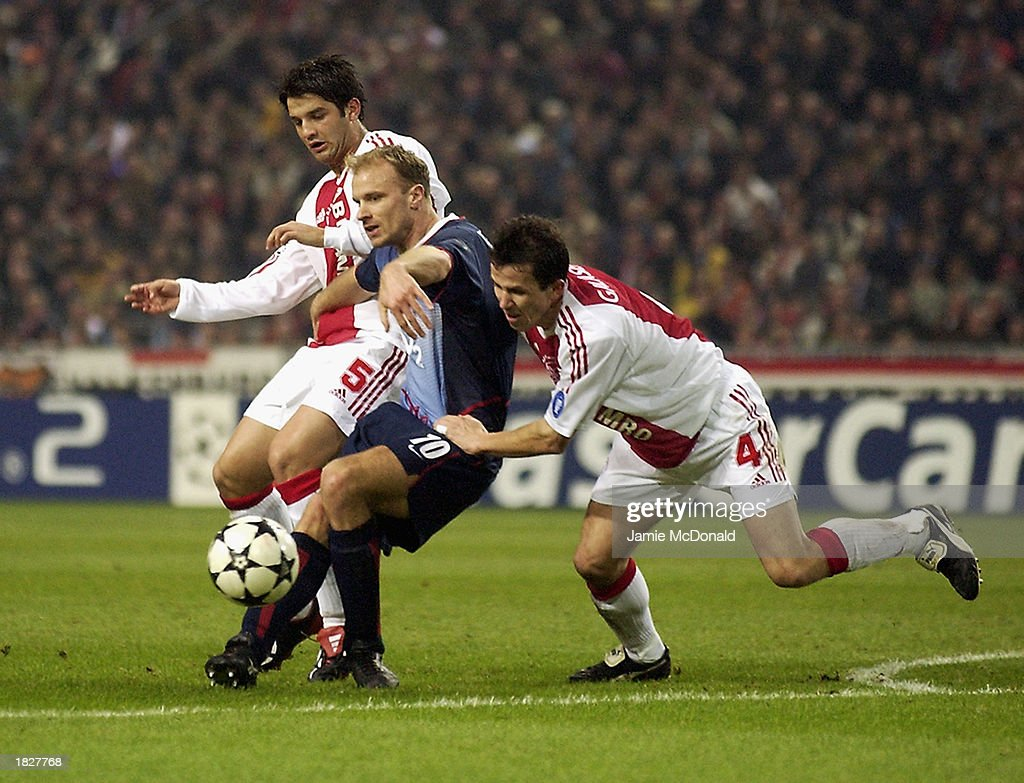 Dennis bergkamp of arsenal and cristian chivu and tomas galasek of dennis bergkamp of arsenal shields the ball from cristian chivu and tomas galasek of ajax during thecheapjerseys