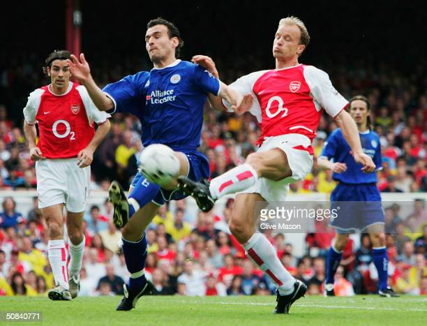 Dennis Bergkamp of Arsenal takes a shot at goal while he battles with Nicos Dabizas of Leicester City during the FA Barclaycard Premiership match...