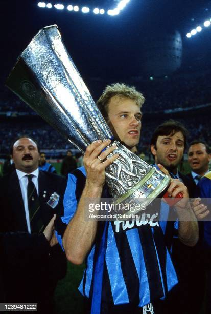 Dennis Bergkamp of FC Interanzionale celebrates the victory with the trophy after the Final UEFA Cup 1994 match between Austria Salzburg and FC...