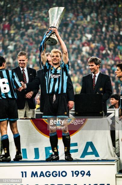 Dennis BERGKAMP of Inter celebrate the victory with the trophy during the UEFA Cup Final second leg match between Internazionale and Austria Salzburg...
