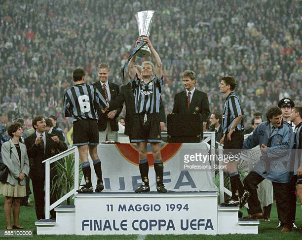 Dennis Bergkamp of Inter Milan holding the trophy following the UEFA Cup Final 2nd leg between Inter Millan and Salzburg at the Stadio Giuseppe...