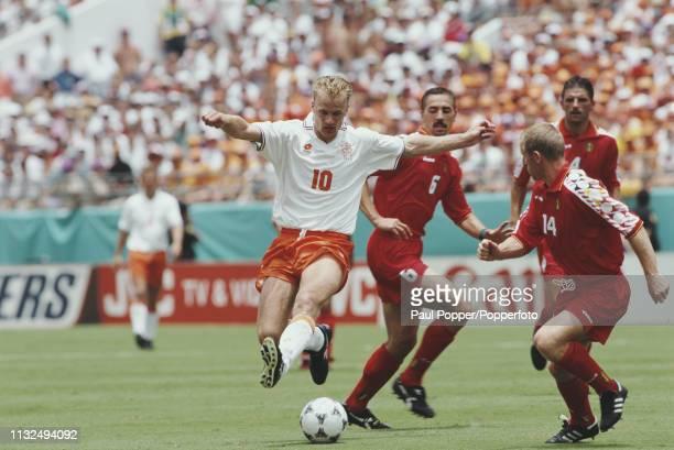 Dennis Bergkamp of Netherlands pictured over the ball as Belgian players Marc Degryse and Michel de Wolf move in during play between Belgium and...