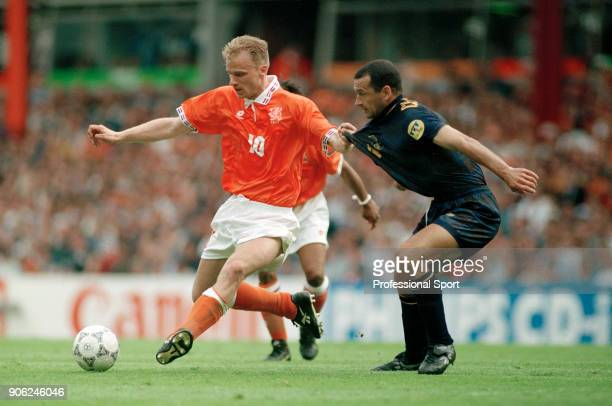 Dennis Bergkamp of the Netherlands holds off Colin Calderwood of Scotland during their UEFA Euro96 Group A match at Villa Park in Birmingham on 10th...