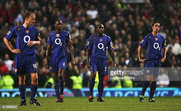 Dennis Bergkamp Patrick Vieira Sol Campbell and Edu look on after Wayne Rooney's goal during the FA Barclays Premiership match between Manchester...