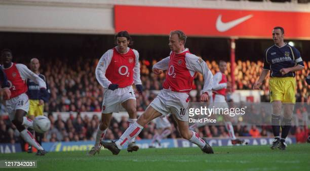 Dennis Bergkamp scores a goal for Arsenal against Oxford during the FA Cup 3rd round match between Arsenal and Oxford United on January 10 2003 in...