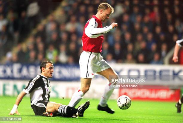 Dennis Bergkamp scores a goal for Arsenal during the Premier League match between Newcastle United and Arsenal on March 2, 2002 in Newcastle, England.