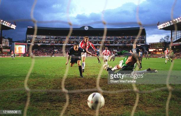 Dennis Bergkamp scores goal for Arsenal during the FA Cup 4th Round match between Farnborough and Arsenal on January 25 2003 in London England