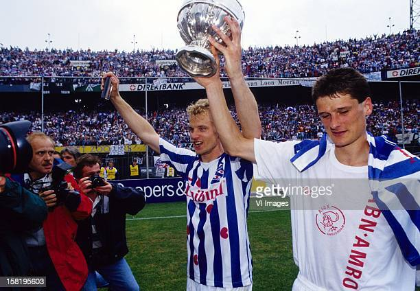 Dennis Bergkamp , Wim Jonk hold the cup after the Dutch Cup final match between Ajax and SC Heerenveen on May 20, 1993 at the Kuip stadium in...