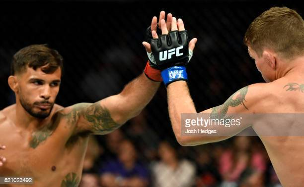 Dennis Bermudez and Darren Elkins touch gloves to start their featherweight bout during the UFC Fight Night event inside the Nassau Veterans Memorial...
