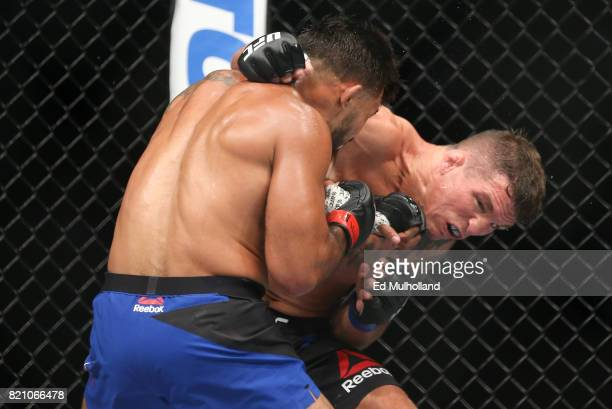 Dennis Bermudez and Darren Elkins trade punches during their UFC Fight Night featherweight bout at the Nassau Veterans Memorial Coliseum on July 22...