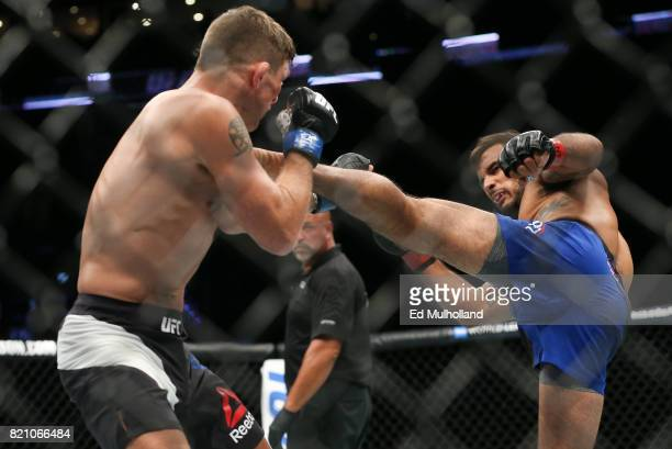 Dennis Bermudez lands a kick on Darren Elkins during their UFC Fight Night featherweight bout at the Nassau Veterans Memorial Coliseum on July 22...