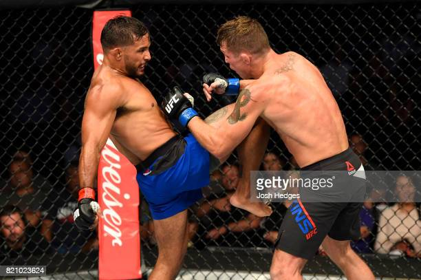 Dennis Bermudez lands a knee to the chest of Darren Elkins in their featherweight bout during the UFC Fight Night event inside the Nassau Veterans...
