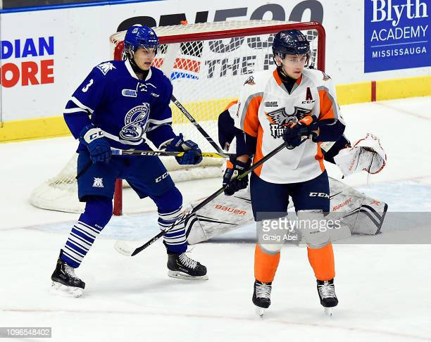 Dennis Busby of the Flint Firebirds battles with Richard Whittaker of the Mississauga Steelheads during OHL game action on January 18 2019 at...