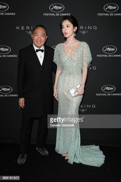 Dennis Chan and Nazha attend the Women in Motion Awards Dinner presented by Kering and the 71th Cannes Film Festival at Place de la Castre on May 13...