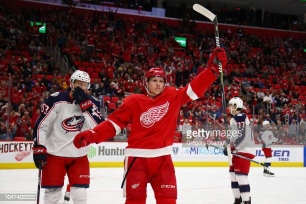 Dennis Cholowski of the Detroit Red Wings celebrates his first NHL goal in the first period while playing the Columbus Blue Jackets at Little Caesars...