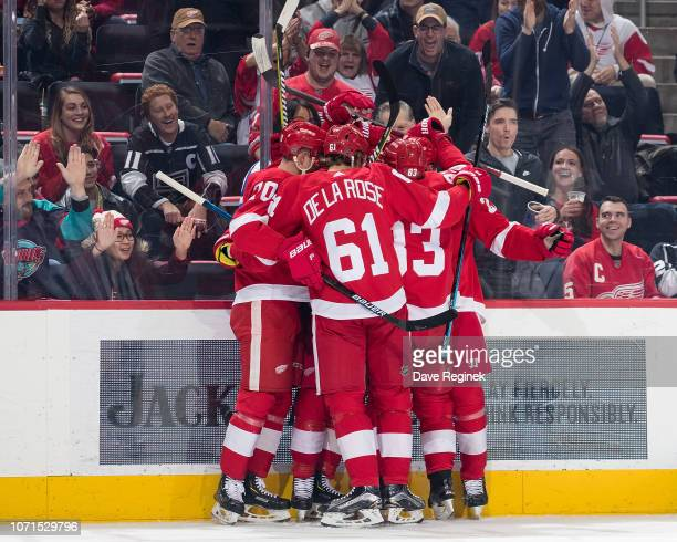 Dennis Cholowski of the Detroit Red Wings celebrates his first period goal with teammates Christoffer Ehn Jacob De La Rose and Trevor Daley during an...