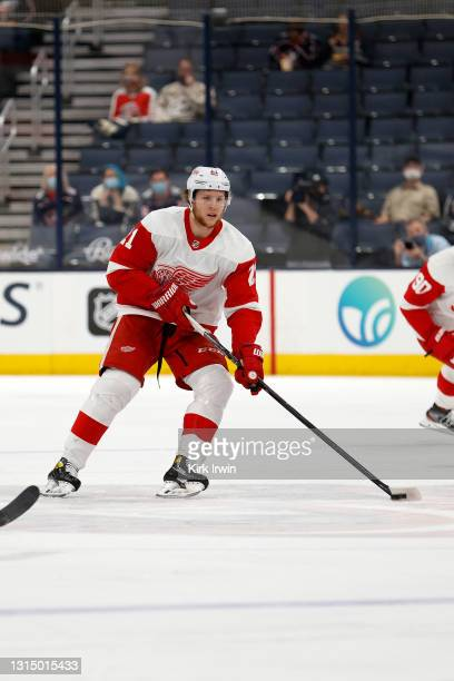 Dennis Cholowski of the Detroit Red Wings controls the puck during the game against the Columbus Blue Jackets at Nationwide Arena on April 27, 2021...