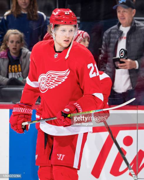 Dennis Cholowski of the Detroit Red Wings flips the puck with his stick blade in in warm ups prior to an NHL game against the Philadelphia Flyers at...