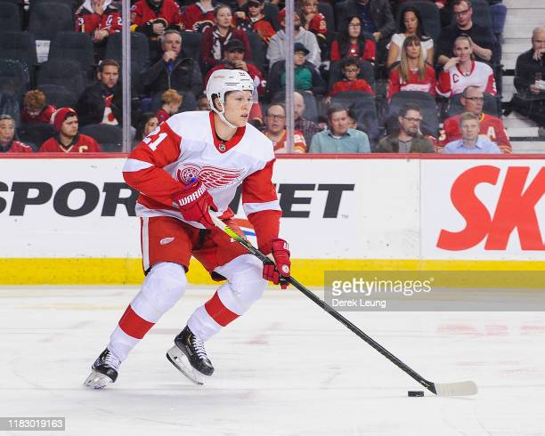Dennis Cholowski of the Detroit Red Wings in action against the Calgary Flames during an NHL game at Scotiabank Saddledome on October 17, 2019 in...