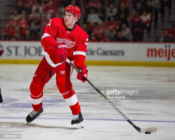 Dennis Cholowski of the Detroit Red Wings looks to pass the puck against the Florida Panthers during an NHL game at Little Caesars Arena on December...