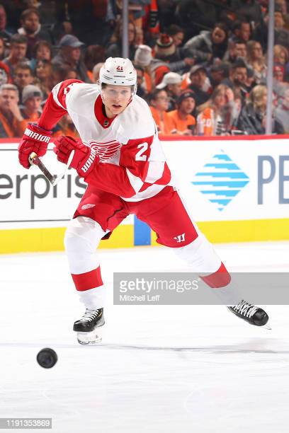 Dennis Cholowski of the Detroit Red Wings skates after the puck against the Philadelphia Flyers at the Wells Fargo Center on November 29, 2019 in...