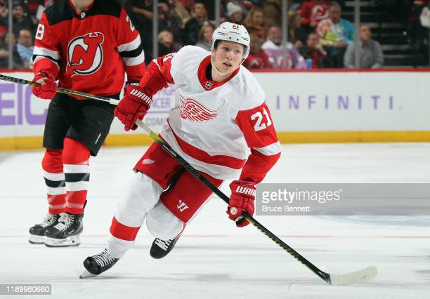 Dennis Cholowski of the Detroit Red Wings skates against the New Jersey Devils at the Prudential Center on November 23, 2019 in Newark, New Jersey....