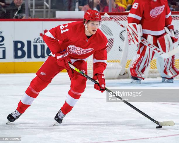 Dennis Cholowski of the Detroit Red Wings skates up ice with the puck against the Washington Capitals during an NHL game at Little Caesars Arena on...