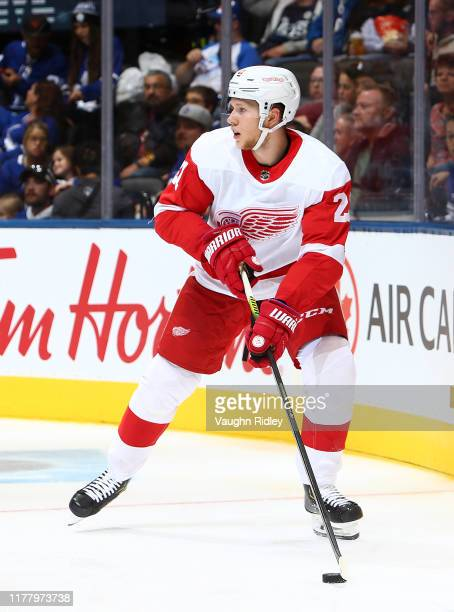 Dennis Cholowski of the Detroit Red Wings skates with the puck during an NHL preseason game against the Toronto Maple Leafs at Scotiabank Arena on...