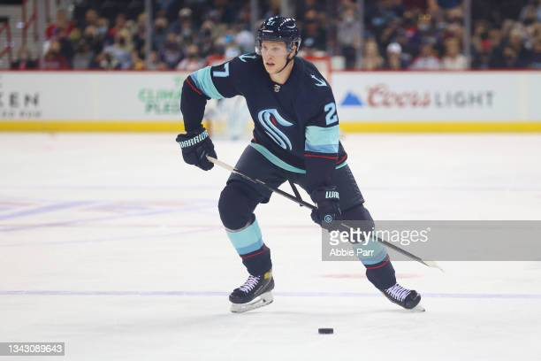 Dennis Cholowski of the Seattle Kraken skates with the puck against the Vancouver Canucks in the first period during a preseason game at Spokane...