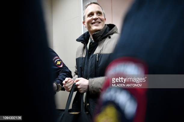 Dennis Christensen is escorted inside a courthouse during a break in the reading of his verdict in the town of Oryol on February 6 2019 A Russian...