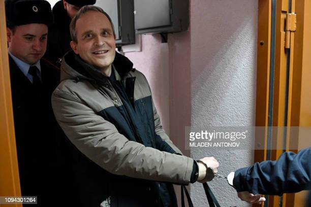 Dennis Christensen is escorted inside a courthouse following the verdict announcement in the town of Oryol on February 6 2019 A Russian court on...