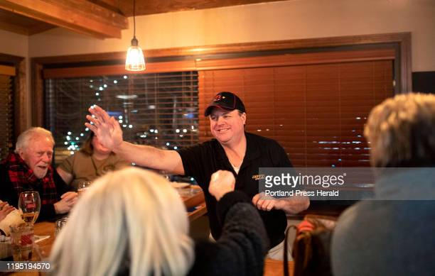 Dennis Coffey walks down the bar highfiving patrons after his second Jeopardy win at Duffys Tavern and Grill where he works as a bartender on Monday...