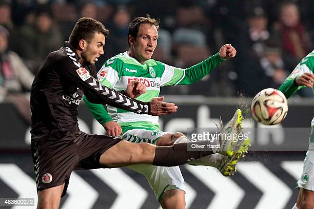 Dennis Daube of Hamburg and Sebastian Freis of Fuerth compete during the Second Bundesliga match between FC St Pauli and Greuther Fuerth at...
