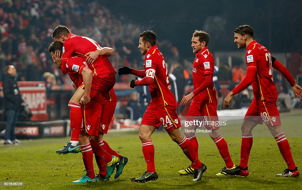 Dennis Daube of Union Berlin celebrates with team mates after scoring his team's second goal during the Second Bundesliga match between 1. FC Union Berlin and Eintracht Braunschweig at Stadion An der Alten Foersterei on December 5, 2016 in Berlin, Germany.
