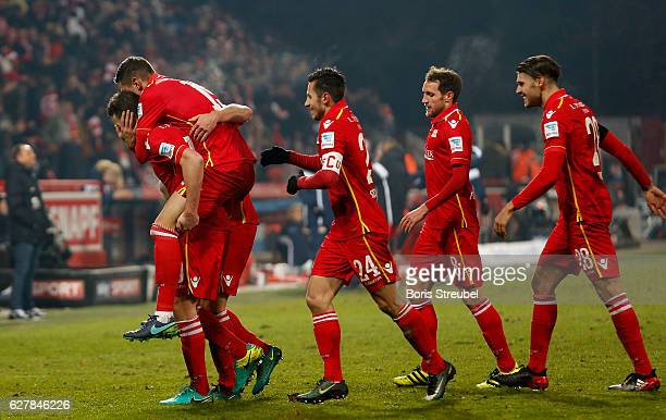 Dennis Daube of Union Berlin celebrates with team mates after scoring his team's second goal during the Second Bundesliga match between 1 FC Union...