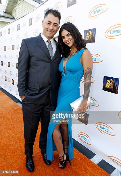 Dennis Desantis and guest attend the Lupus LA's Orange Ball A Night of Superheroes at the Fox Studio lot on June 6 2015 in Century City California