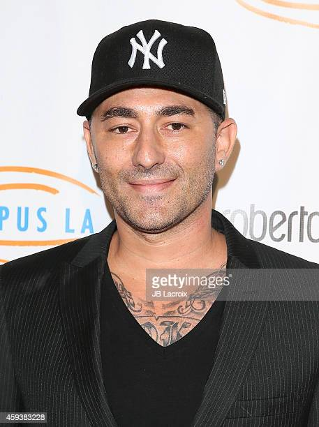 Dennis Desantis arrives at the 12th Annual Lupus LA Hollywood Bag Ladies Luncheon at The Beverly Hilton Hotel on November 21 2014 in Beverly Hills...