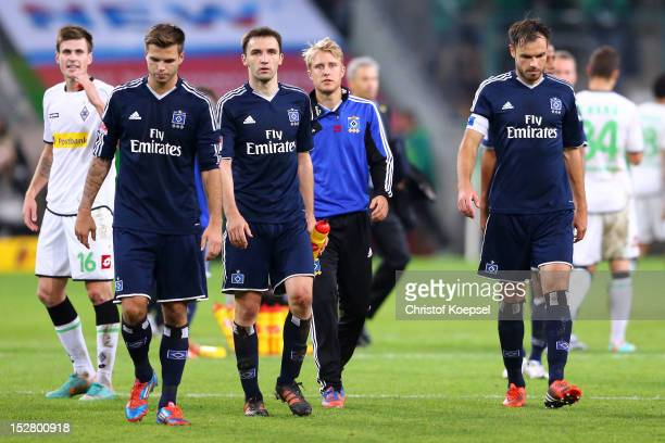 Dennis Diekmeier Milan Bedelj Per Ciljan Skjelbred and Heiko Westermann of Hamburg look dejected after the 22 draw of the Bundesliga match between...