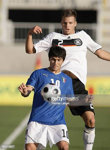 Dennis Diekmeier of Germany and Martin fernando Forestieri; of Italy battle for the ball l during the U19 European Championship final match between...
