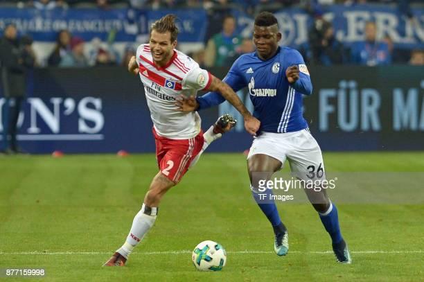 Dennis Diekmeier of Hamburg and Breel Embolo of Schalke battle for the ball during the Bundesliga match between FC Schalke 04 and Hamburger SV at...
