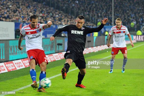 Dennis Diekmeier of Hamburg and Christian Clemens of Koeln battle for the ball during the Bundesliga match between Hamburger SV and 1 FC Koeln at...