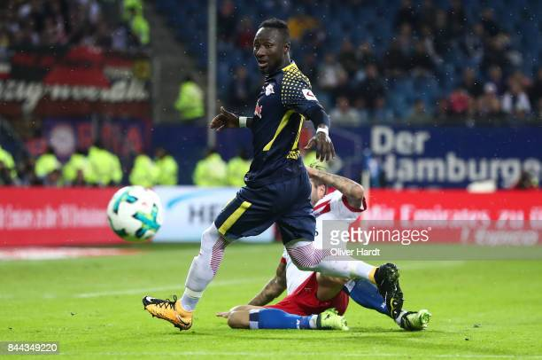 Dennis Diekmeier of Hamburg and Naby Keita of Leipzig compete for the ball during the Bundesliga match between Hamburger SV and RB Leipzig at...