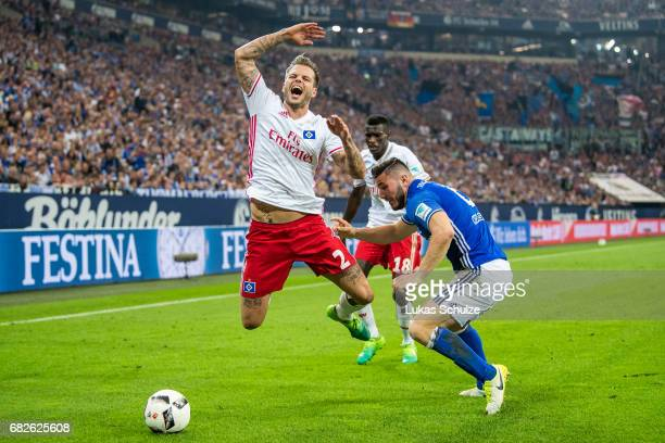 Dennis Diekmeier of Hamburg and Sead Kolasinac of Schalke fight for the ball during the Bundesliga match between FC Schalke 04 and Hamburger SV at...